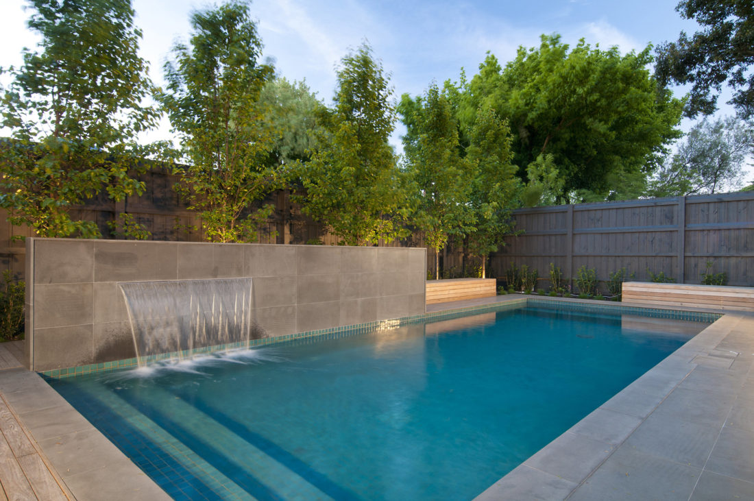 Fully tiled family pool with water feature
