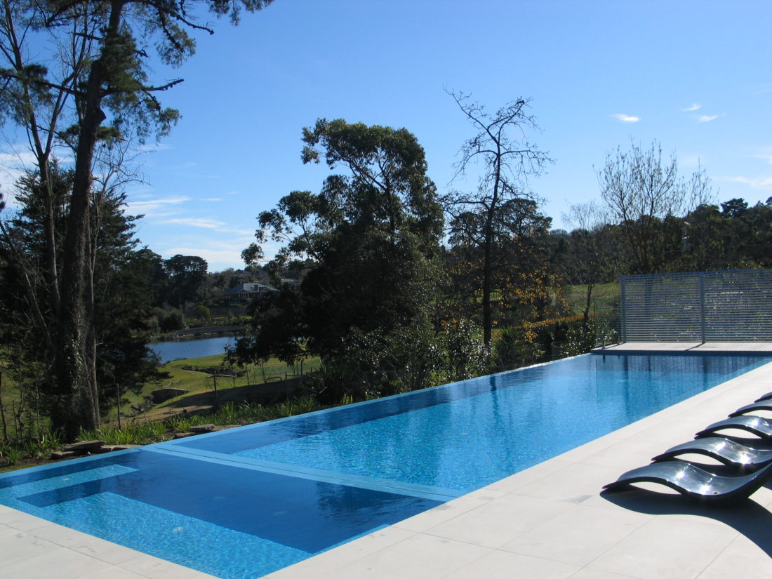 How long does it take to build a concrete pool neptune for Infinity swimming pools pictures